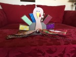Wooden turkey with ribbons